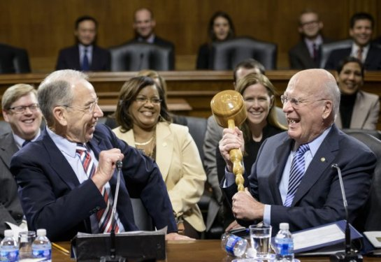 New Senate Judiciary Committee Chairman Sen. Chuck Grassley, left, receives a gavel from Sen. Patrick J. Leahy Thursday.