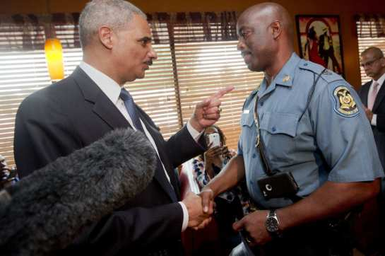 Eric Holder talks with Captain Ron Johnson of the Missouri State Highway Patrol on August 20, 2014 in Florrissant, Missouri. Photo: Pablo Martinez Monsivais-Pool/Getty Images