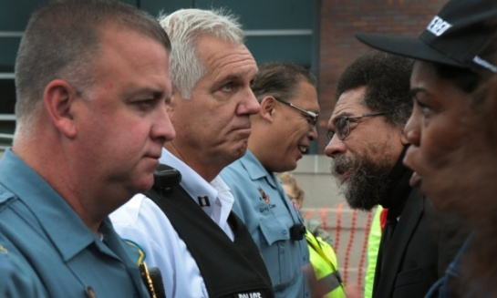 Cornel West (second from right) speaks to Ferguson police captain Rick Henke as clergy confront officers in front of the Ferguson police department in October. Photograph: Robert Cohen/Post-Dispatch/Polaris
