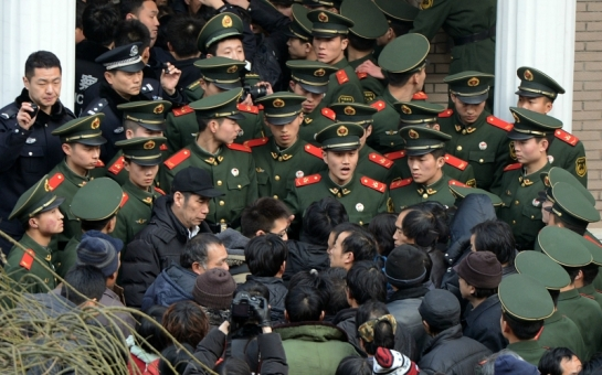 Mad in China: a labor protest in Beijing, January 2013 (Mark Ralston / AFP / Getty Images)