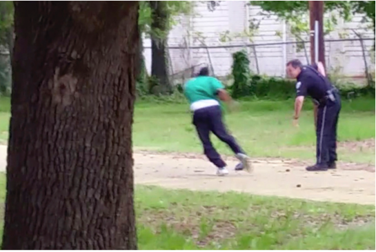 Michael Thomas Slager, right, pulls out his handgun as Walter Scott runs away from him, April 4, 2015, in North Charleston, S.C. (Credit: AP/Courtesy of L. Chris Stewart)