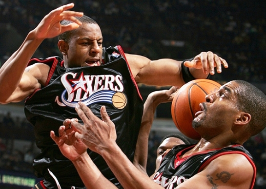 Corliss Williamson and Andre Iguodala of the Philadelphia 76ers grab for the ball during a game against the Chicago Bulls on Jan. 12, 2005, at the United Center in Chicago. The Bulls defeated the 76ers 110–78. Jonathan Daniel / Getty Images