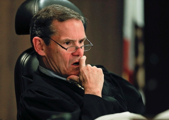 Judge Thomas Goethals listens to arguements during a motion hearing in the trial of Scott Dekraai on March 18, 2014 in Santa Ana, California. Photo by Mark Boster/Pool via Getty Images