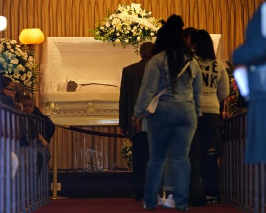 Mourners line up to see the body of Freddie Gray last month.