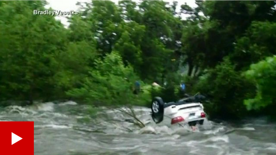 Media caption Footage showed cars being washed away and the aftermath of flooding in the US