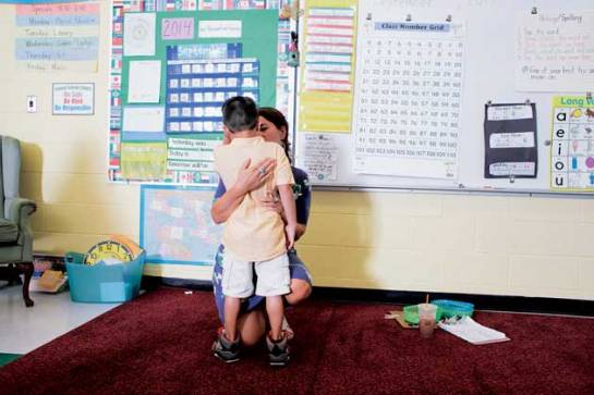 June Arbelo, a second-grade teacher at Central School, comforts a student who wants to go home during the first day of school. Tristan Spinski/GRAIN