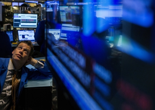 A trader on the floor of the New York Stock Exchange during Wednesday's outage. Photo by Lucas Jackson