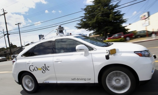In this 13 May 2015 photo, Google's self-driving Lexus car drives along street during a demonstration at Google campus in Mountain View, California. Photograph: Tony Avelar/AP