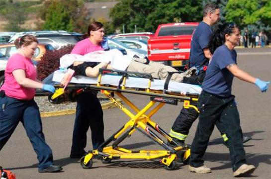 First responders transport an injured person following a shooting incident at Umpqua Community College in Roseburg, Oregon Oct. 1, 2015. Photo by Michael Sullivan/The News-Review via Reuters