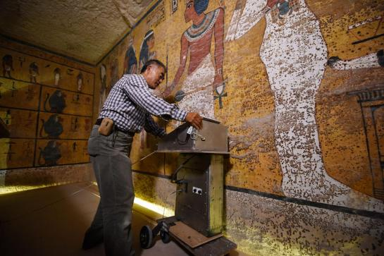 Hirokatsu Watanabe, a radar specialist from Japan, pushes his specially modified Koden-brand machine along the north wall of Tutankhamun's burial chamber.  PHOTOGRAPH BY BRANDO QUILICI, NATIONAL GEOGRAPHIC CHANNELS