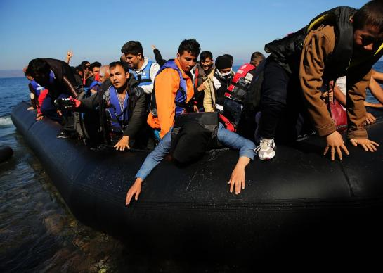 People disembark from a raft moments after arriving from Turkey on October 15, 2015 in Sikaminias, Greece. Photo by Spencer Platt/Getty Images
