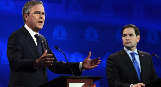 Jeb Bush speaks as Marco Rubio looks on during the CNBC Republican Presidential Debate. | Getty