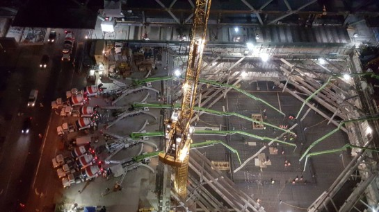 Seven pumps equipped with massive booms moved concrete from truck to foundation.  BOSTON PROPERTIES Gallery Image