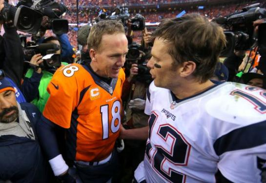 Peyton Manning and Tom Brady share a moment after Denver's 20-18 victory in the AFC Championship game. Photo by Justin Edmonds/Getty Images