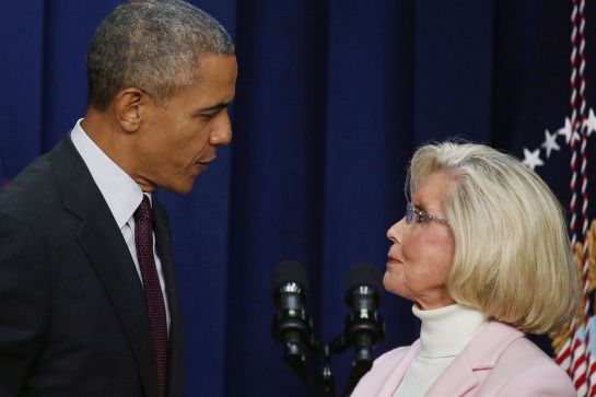 President Obama stands with Lilly Ledbetter on the seventh anniversary of the equal pay bill named after her. -- Mark Wilson/Getty Images