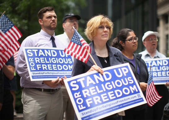 Fellow religious freedom supporters hold a rally on June 30, 2014, in Chicago. -- Scott Olson/Getty Images