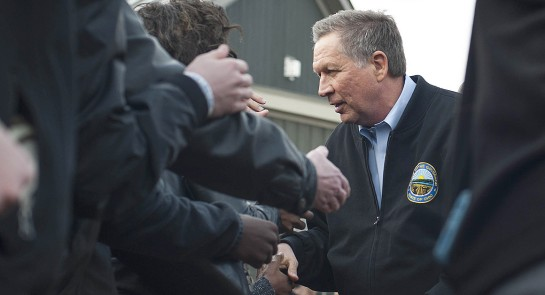 John Kasich shakes hands with attendants in the crowd after speaking at a campaign rally at the Wells Barns at the Franklin Park Conservatory on March 6, 2016, in Columbus, Ohio. | Getty