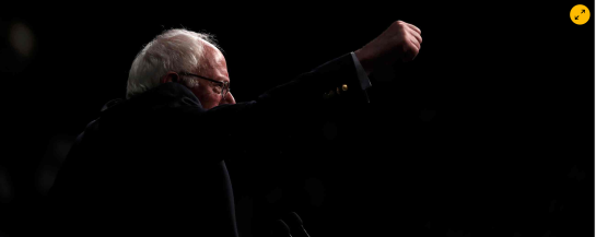 Senator Bernie Sanders speaks to supporters on the night of the Michigan primary. Photograph: Carlo Allegri/Reuters