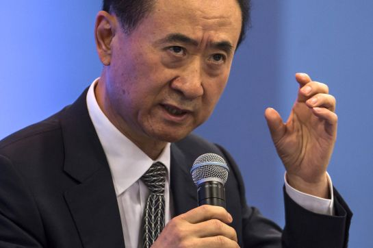 "Billionaire Wang Jianlin, chairman and president of Dalian Wanda Group Co., speaks during the Hong Kong Asian Financial Forum (AFF) in Hong Kong, China, on Monday, Jan. 18, 2016. Dalian Wanda Group, the property-to-entertainment conglomerate headed by Asia's richest man, is planning five ""substantial"" acquisitions this year as the company braces for a drop in sales. Photographer: Justin Chin/Bloomberg *** Local Caption *** Wang Jianlin"