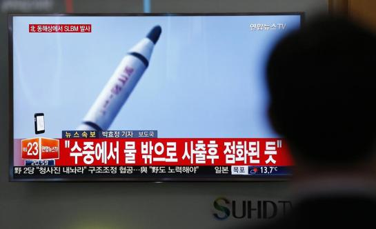 """A man watches a TV news program showing a file footage of a missile launch conducted by North Korea, at the Seoul Train Station in Seoul, South Korea, Saturday, April 23, 2016. North Korea on Saturday fired what appeared to be a ballistic missile from a submarine off its northeast coast, South Korean defense officials said, Pyongyang's latest effort to expand its military might in the face of pressure by its neighbors and Washington. The Korean letters at top left read: """"North Korea fires a submarine-launched ballistic missile or SLBM."""" (AP Photo/Lee Jin-man)"""