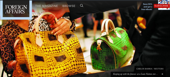 CARLOS BARRIA / REUTERS -- Keeping up with the Joneses: at a Louis Vuitton store in Shanghai, September 2012
