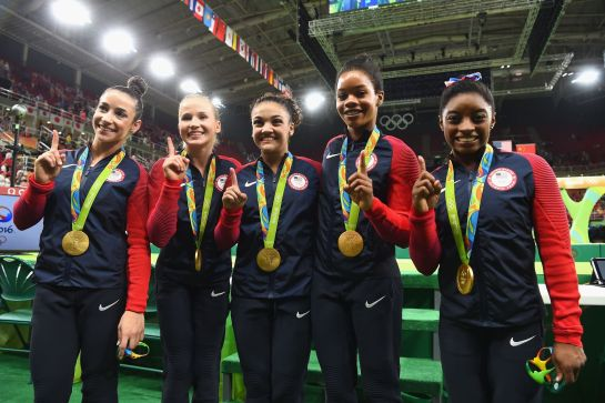 RIO DE JANEIRO, BRAZIL - AUGUST 09: (L to R) Gold medalists Alexandra Raisman, Madison Kocian, Lauren Hernandez, Gabrielle Douglas and Simone Biles of the United States pose for photographs with their medals after the medal ceremony for the Artistic Gymnastics Women's Team on Day 4 of the Rio 2016 Olympic Games at the Rio Olympic Arena on August 9, 2016 in Rio de Janeiro, Brazil. (Photo by Laurence Griffiths/Getty Images)