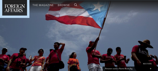 REUTERS  Portestors wave a Puerto Rican flag.