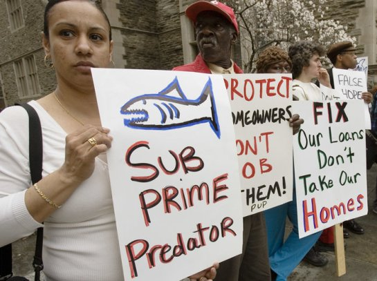 Demonstrators in Philadelphia in 2008 try to draw attention to the subprime mortgage crisis. Philadelphia is one of the cities backing Miami's efforts to sue Wells Fargo and Bank of America. | Matt Rourke/AP