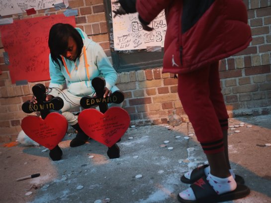 Friends and family members attend a memorial service for 17-year-old twin brothers Edward and Edwin Bryant who were shot and killed in October. Chicago has logged more than 700 homicides this year, more than any other major U.S. City Scott Olson/Getty Images