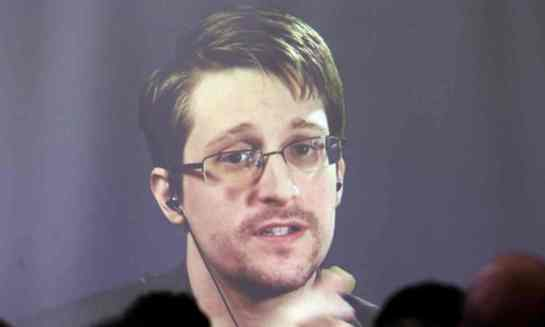 Edward Snowden appears via video link during a conference in Argentina in November 2016. Photograph: Marcos Brindicci/Reuters