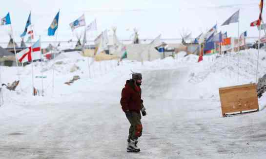 A man walks through the Dakota Access Pipeline protest camp on the edge of the Standing Rock Sioux reservation near Cannon Ball, North Dakota Tuesday. Photograph: Terray Sylvester/Reuters