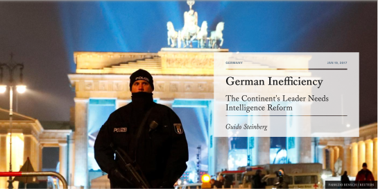 FABRIZIO BENSCH / REUTERS  A German policeman stands in front of the Brandenburg Gate on New Year's Eve, 2016