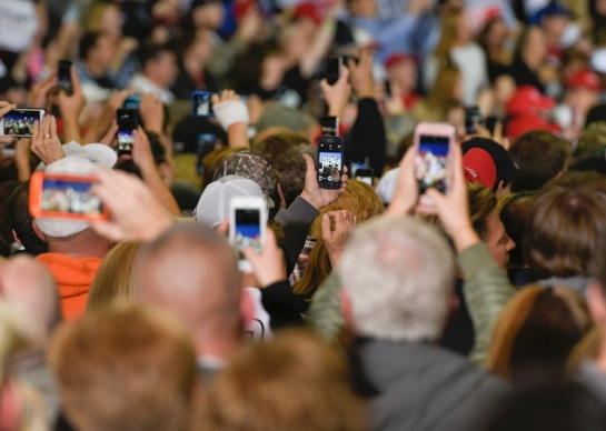 Supporters of Donald Trump film him on their phones as he speaks during a rally in Geneva, Ohio, on Oct. 28. Dustin Franz/Getty Images