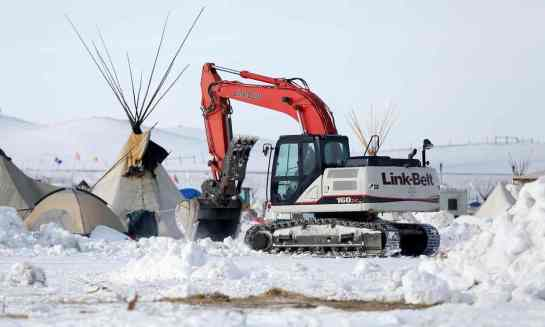 Crews remove waste from the camp opposing the Dakota Access pipeline near Cannon Ball, North Dakota. Photograph: Terray Sylvester/Reuters