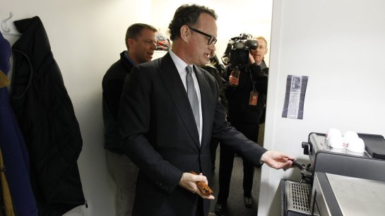 Tom Hanks visits his old espresso machine during a visit to the White House March 11, 2010. Alex Brandon/AP