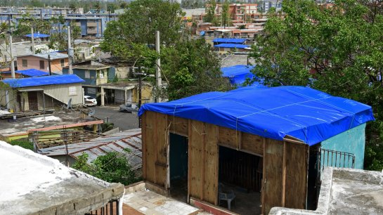 Homes in the Cantera area of San Juan, Puerto Rico are covered with FEMA tarps after Hurricane Maria. The island is now bracing for another major storm. Carlos Giusti/AP